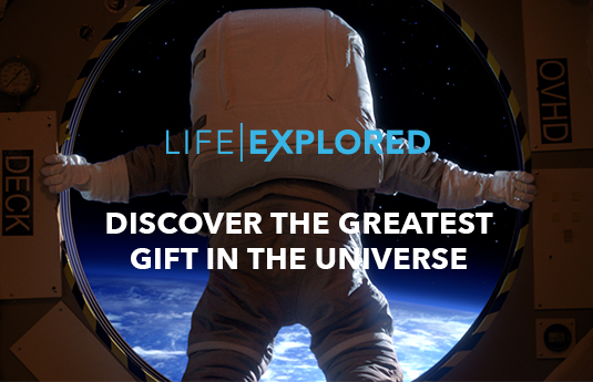 Discover the greatest gift in the universe - astronaut overlooking earth
